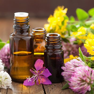 essential oil bottles with yellow and purple flowers